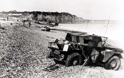 The beach at Dieppe after the raid, showing an abandoned scout car